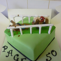 Horse Racing Cake the horses were originally standing up but on the morning of it being picked up i opened the box to check it and the front horses back legs...