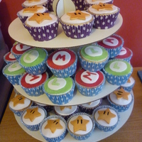Mario Theme Cupcakes mario cupcakes. i had to make 50 mario cupcakes and only had a few hours to do it so this was the best i could manage for the short time i...
