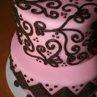 Baby Shower Pink rolled fondant with brown icing swirl and diamond decorations.