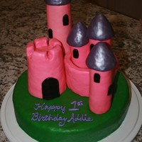 Sculptured Princess Castle Cake Rice Krispie sculpted turrets, covered in fondant, dusted with glitter powder. Crafted for a little girl's 1st birthday party.