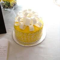 Yellow Shower Cake This is a cake I made for my best friend's bridal shower. Her wedding colors are yellow and gray. Everything is buttercream icing...