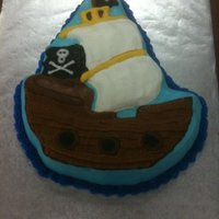 Pirate Ship Cake The cake was made with a Wilton Pirate ship cake pan. Icing is buttercream that I smoothed out.
