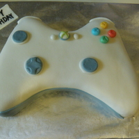 Xbox 360 The cake is french vanilla with buttercream icing, covered with marshmellow fondant.