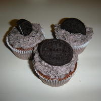 Oreo Cupcakes Cake is chocolate. Icing is mixed with crushed oreos.