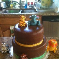 Jungle Cake I made this cake for a friend's baby shower. This was my first time using fondant. The animals and borders are marshmellow fondant....