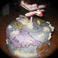 Hello Kitty Birthday Cake!  Girl wanted a cake to do with Hello Kitty and Flying / Airplanes, and here's what I came up with. The plane was made from fondant and...
