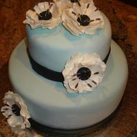 Tall Cake Class blue cake with black and white anemones