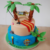 Beach/tiki Hammock Cake  birthday boy and hammock are polymer clay (so he can keep it in his office after) and everything else is fondant. around the cake is more...