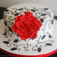 Red Rose Anniversary Cake   nothing too special. red velvet cake with cream cheese icing, gumpaste rose, roysl icing details and everything else is fondant. TFL!