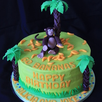 Go Bananas Birthday Cake Marble cake covered in vanilla buttercream. Fondant accents. Palm trees are pretzel rods covered in fondant. Monkey and bananas are fondant...
