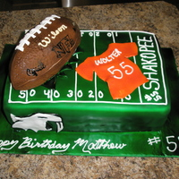 Football Cake This cake is double layered marble cake with buttercream. Fondant decorations. The football is out of cake.