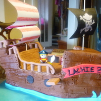 Buttercream Pirate Ship  choc butter cream covered pirate ship with fondant decorations. lots of fun, for a 3 yr olds bday, he was very excited and stoop...