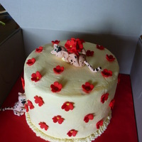 Red Flower Cake   red flower, buttercream covered and cheeky cheetah cake