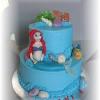 The Little Mermaid White cake with fresh strawberries and french vanilla buttercream frosting. Ariel and flounder were made from fondant....and boy do I need...