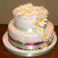 Yellow Daisy Fun! Top cake, triple layer chocolate swirl with buttercream layers. Bottom Cake, butter cake with vanilla bavarian creme. Covered with vanilla...
