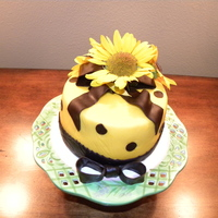Sunflower Sweets White chocolate cake with buttercream layers, chocolate filling and topped with almond and chocolate fondant. Fresh Sunflowers from my four...