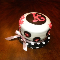 Katy's Surprise Cake Fondant covered butter cake with fondant monogram and flower cut outs.