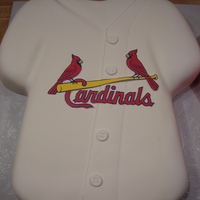 Cardinals Jersey   Used Wilton t-shirt pan, covered in MMF with MMF buttons. I ran out of time, so the logo is just paper.