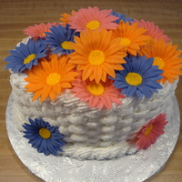 Daisy Basket Oval cake with buttercream basket weave and fondant daisies.