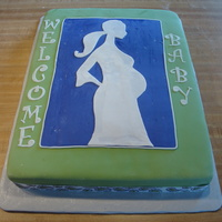 Pregnant Woman 1/2 sheet cake covered in MMF fondant with fondant decorations and satin ribbon on border.