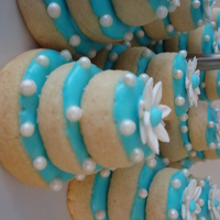 Wedding Shower Cookies   These are almond shortbread cookies, topped with royal icing & sugar pearls with a gumpaste daisy on top.