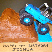 Jeep Cake This is a Jeep cake made for an adorable 4 year old. The Jeep is made of RKT and the cake is chocolate. Lots of fun.