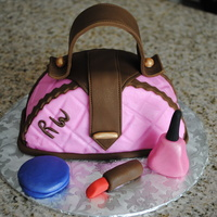 Mini Pink And Brown Purse Cake! Just for fun cake. Mini purse, many inspirations here on CC. TFL! Accents done in fondant and gumpaste.
