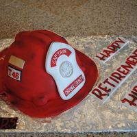 Fire Helmet Captain Red fire helmet for Captain's retirement party. Made the helmet shape from the Wilton Barbie doll cake mold. Covered in fondant and...