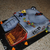 Skate Park Cake 8 in square cake carved to look like a skatepark. Stairs are RK treats, ramp in cake. All covered in Fondant. Boy and extras done in...