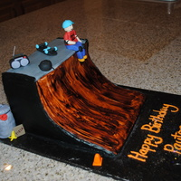 Half Pipe Skate Ramp Cake Carved chocolate cake to look like a skate ramp. Back and top covered in buttercream, ramp side covered in fondant and painted to look like...