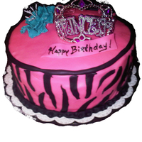 Pink Zebra Cake  This cake was for a friend of the family, they wanted something frilly and girly. The crown is plastic. This was my first attempt at zebra...