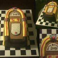 Jukebox Mini-Cake  I used a loaf pan and rounded out the top. I used silver petal dust for the accents. Fun cake to make for my best friend's dad - he...