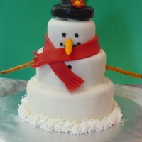 Snowman Cake  This was my first time using Marshmallow Fondant, and I will NEVER use anything else! It was so inexpensive and easy to make, and it tasted...
