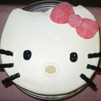 Hello Kitty Cake  Hello Kitty birthday cake. It's a vanilla cake with smoothed buttercream icing. For the bow I rolled gumdrops flat in sugar and cut...