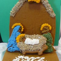 Gingerbread Nativity Scene  For this nativity scene, I melted hard lemon candies to make a stained glass center for the star, and used frosted mini wheats for the hay...