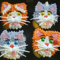 Kitty Cat Cupcakes  This is my variation on the Hello, Cupcake! Kitty Cat Cupcakes.These were vanilla cupcakes with buttercream fur, royal icing whiskers, mini...