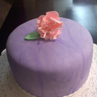 Purple Flower Cake Fondant decorations with gumpaste flower.