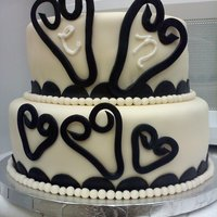Ivory/black Heart Cake I made this cake for a small wedding. The bride/groom's colors were ivory (bride's dress) with black (groom's tux) and they...