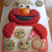 Elmo's The Birthday Baker This was from the Wilton 2009 Book, and was for my Great Niece's first birthday, Her mother did not want any fondant on it as it was...
