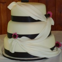 Simple But Elegant French Vanilla and Chocolate cake with Strawberry filling covered in fondant.