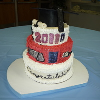 Graduation Cake grad cake topped with a grad captassel broke in transport