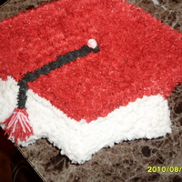 Sflh Graduation Graduation cap on a half of sheet cake