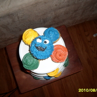 Elmo Elmo face with Sesame Street Sign with Birthday Boy name and age. Cookie Monster cupcake.