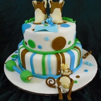 Monkey Shower Baby shower cake, put feet on board- styrofoam balls. I hope they hold up!Fondant, rattle styro covered w/fondant. Inspired by CCer's...