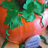 Pumpkin Cake!! Used two bundt cakes, covered and shaped with buttercream. Vines and leaves are gumpaste.