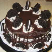 Oreo Cake   Chocolate cake with Oreo filling and chocolate ganache topping.