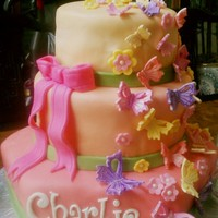 Butterfly Cake Three tiered cake with white chocolate fondant cake with butterfly and flower design for a baby girl named Charlie