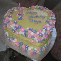 Birthday Cake Plain yellow cake with buttercream and royal icing flowers made for my grand daughter's second birthday. This is the second cake I...