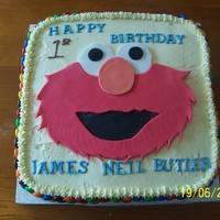 Elmo Birthday Cake vanilla buttercake with buttercream icing, fondant elmo face & lettering. M&M lollies around the sides.