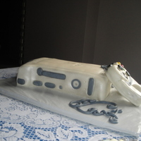 "Xbox Grooms Cake This is my first ""carved"" cake and RKT piece. The cake is chocolate fudge with MMF and the controller is RKT with MMF."